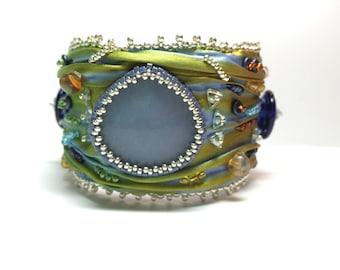 Shibori silk bead embroidered cuff bracelet with angelite cabochon