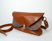 Brown leather bag with blue silk screenprint