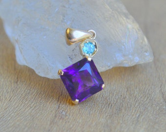 Amethyst from Uruquay set in 14 Kt Yellow Gold with Paraiba Tourmaline Hexagon Accent