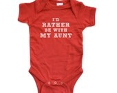 "Cute ""I'd Rather Be With My Aunt"" White or Black Design on Multiple Colors Light or Dark Short Sleeve Baby Bodysuit Gift For Niece or Nephew"