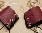 SMALL oxblood red leather Cuffs with black Lace gold Grommets and Black Laces (PAIR)