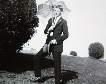 Vintage Old Photo Dandy Man with Umbrella and Hat Outdoors Snapshot Black and White Antique Photograph.