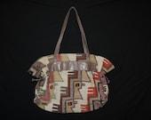 vintage kilim bag. 1980's earthy tribal tapestry / carpetbag purse.