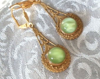 Art Deco style earrings vintage green glass swirly buttons