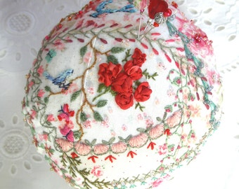 Pincushion, Crazy Patch round in red and pink fabrics with blue bird- Made to Order