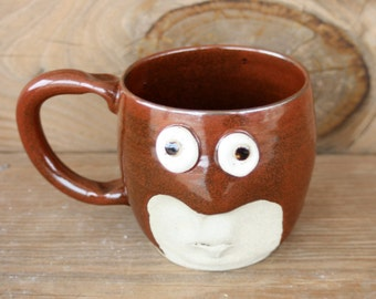 Masked Man Mug. Red Super Hero Coffee Cup. 12 Ounces. Unique Uncommon Face Mugs. Gifts for Him Under 25. Nelson Studio Ug chug