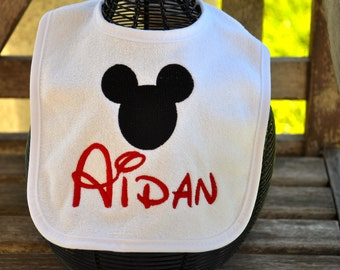 EMBROIDERED Disney BABY BIB with Name.  I also have Minnie ears...Disney font, so your little one will be called by name by the Disney staff