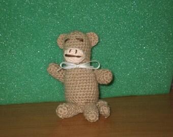 crocheted miniature monkey