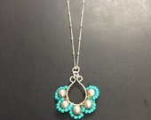 Wire wrapped pendant necklace with silver pearls and turquoise seed beads