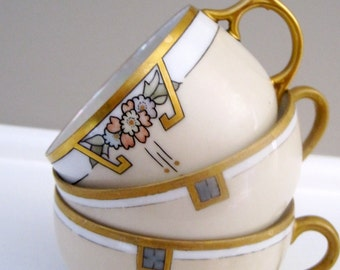 VINTAGE GOLD and WHITE Japanese porcelain tea cups made in Japan gold handles two matching one mismatch pastel colors