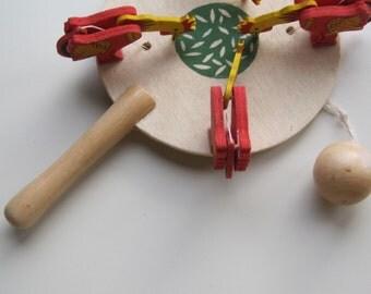 Vintage FOLK ART Paddle Toy