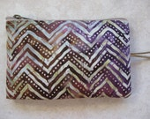 padded zipper pouch in brown zig zag batik print fabric