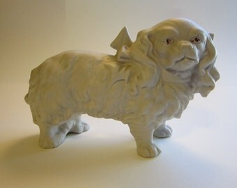 antique white bisque pekingese dog - marked Germany