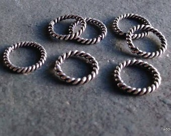 Seven stitch markers, sterling silver over solid twisted copper, rings for knitting (medium)