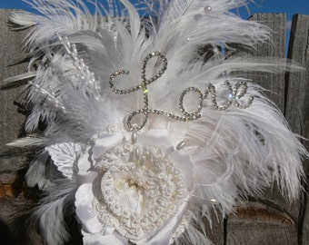 Love Cake Topper in white and ivory ostrich feathers with lace rose and pearls