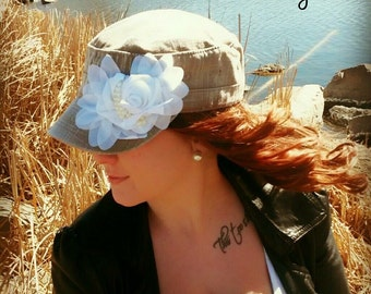 Army hat adorned with a white flower and pearls