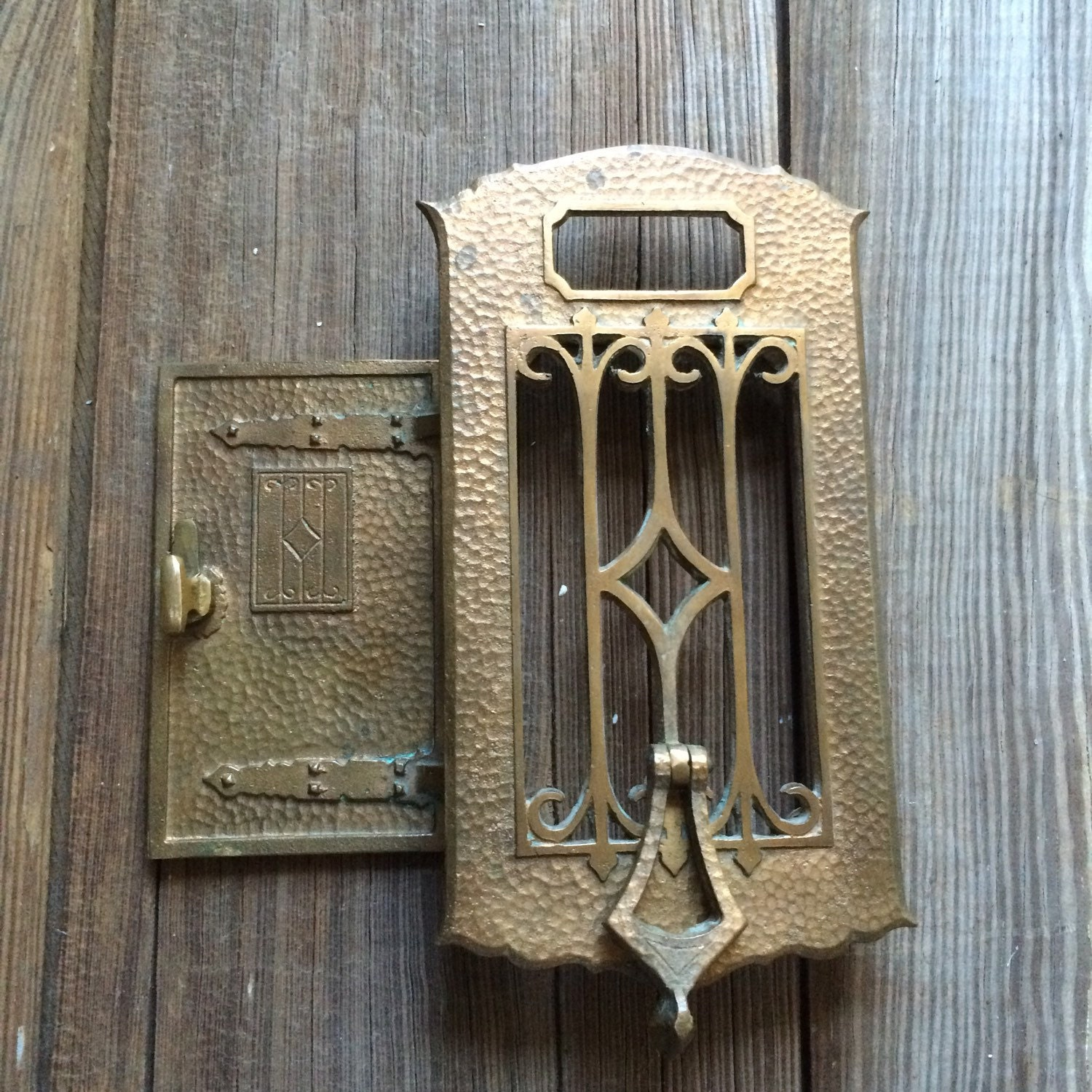 Antique door peepholes a peephole in this antique door is surrounded by a wrought iron grill - Antique peephole ...