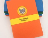 Notebook - handstitched and trimmed A6 cat journal, unlined, orange and yellow, unique design with removable pin badge