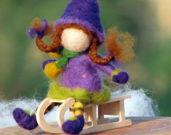 Needle felted doll on sledge, Christmas decoration, Ornament