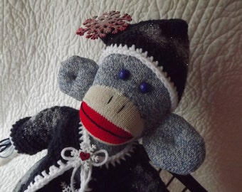 Santa Sock Monkey with Crocheted Blue Winter Snow Snowflake Christmas Outfit and Embellishments