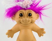 Vintage Russ Bride Troll Doll, Flourescent Fushia Rose Hair, Intense brown eyes with black pupils, Has a white bridal veil with pink roses