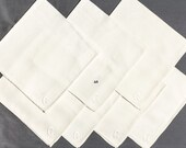 Set of 7 white napkins, Monogramed with the letter G, floral damask design with one quarter inch hem, 20 inches square