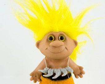 Vintage Caveman Troll Doll, Flourescent Yellow Hair, Intense black eyes, Sharktooth necklace, Plush tigar skin loin cloth