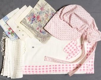 Destash Sunbonnet, 2 printed hankies, 2 white hankies, Crocheted doily Pulled thread table mat, Table cloth with appliqued edges, Teacups