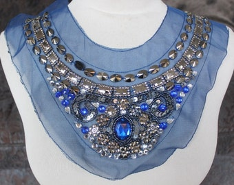 Cute beaded applique with rhinestones royal blue color 14 inches wide at the neck 1 1/2 inches wide the the shoulders