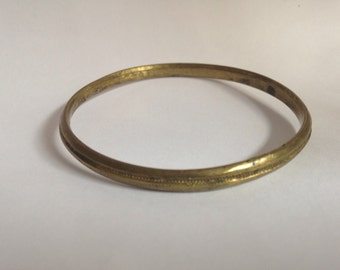 Sweet little child's simple antique gilded baby bangle with milgrain detail