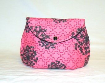 Classic Large Make-Up Bag in a Grey Floral Pattern on Salmon Pink and Red Background