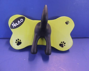 Dog leash holder. Personalized with single tail on hand-made wooden bone.