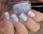 "Nail polish - ""Sugar Free"" multi colour glitter in a white creme base"