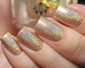 "Nail polish - ""Record Keeper"" light gold linear holographic"