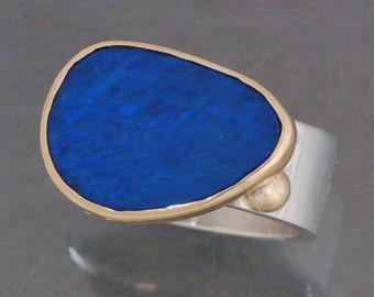 Boulder opal ring in sterling silver and 18 karat gold