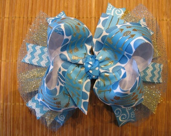 3405 turquoise with gold arrows double ribbon boutique bow with tulle and spikes