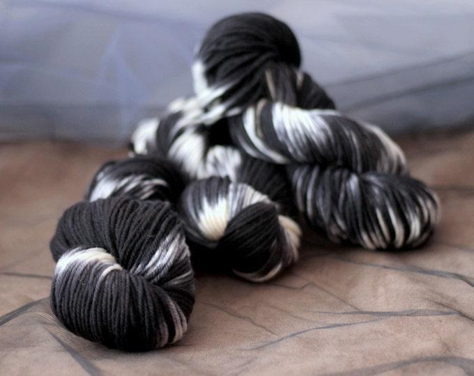 Hand dyed yarn SW Merino , shibori black, DK, 220 yards