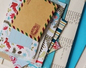 Christmas themed PACK-of-POCKETS in shades of turquoise. A collection of pouches, envelopes & pockets for all your crafty doings