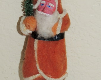 1930s Cotton Santa with Clay Face holding a tree Ornament
