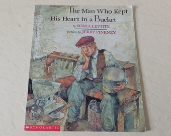 Book: The Man Who Kept His Heart in a Bucket, Scholastic Softcover, 1st Edition, 1994.