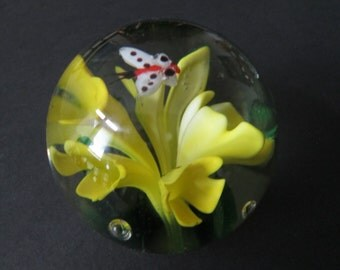 Yellow flowers and butterfly glass paperweight