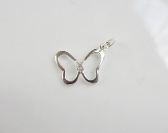 Sterling silver Butterfly cutout pendant with cubic zirconium in the middle (17X15mm)