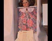 Camille by Marie Osmond and artist Rita Schmidt in a flower dress