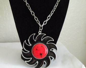 Celebrity Black enamel Pinwheel sun necklace.