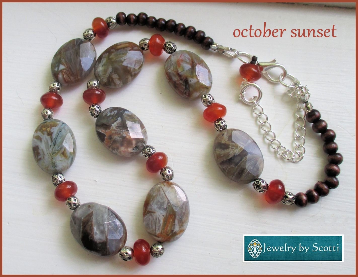 gray and orange gemstone necklace necklace
