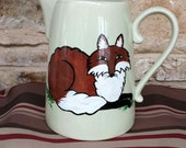 Hand painted one of a kind resting Fox, Fox hunt glass pitcher.