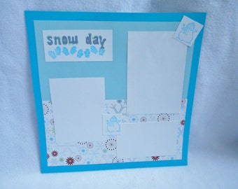 Snow Day 12 x 12 Premade scrapbook page, winter themed scrapbook layout, with snowflakes and hand stamped mittens and snowman accents