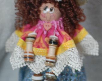 Wooden button dolls