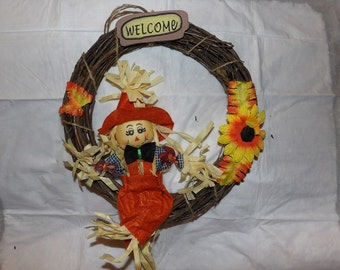 Raffia Scarecrow on a grapevine wreath - hsw6