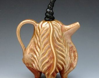 Hand carved porcelain teapot glazed in shino with black lid